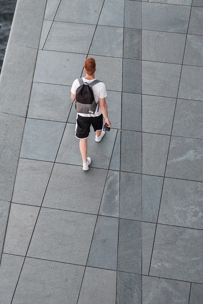 A photographer walking near the German Chancellery in Berlin