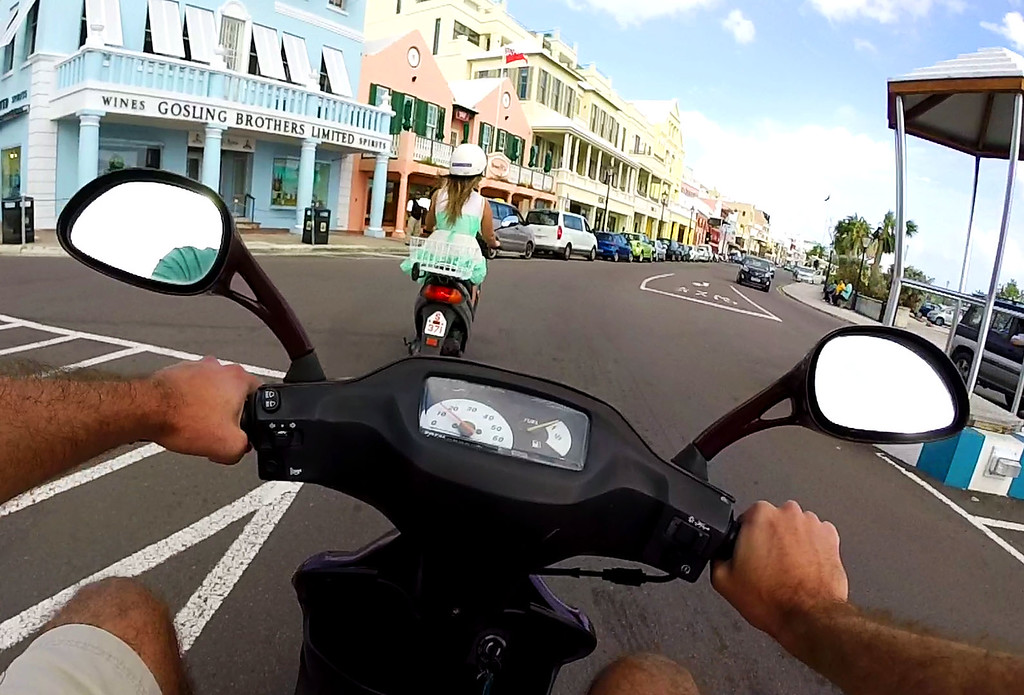 Renting a scooter in Bermuda - Riding down Front Street in Hamilton