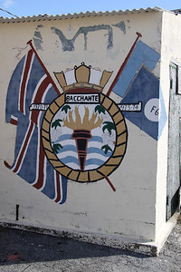 Crest of HMS Bacchante at Dockyard, Bermuda. There have been six Royal Navy ships named HMS Bacchante. The sixth (F69) was a Leander class frigate launched in 1968 and decommissioned in 1982. The dates on the crest indicate that she was in Bermuda in the early 1970's.
