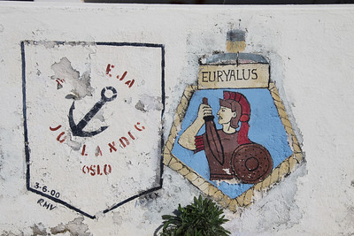 Crest of HMS Euryalus at Dockyard, Bermuda. There have been six Royal Navy ships named HMS Euryalus. The latest (F15) was a Leander class frigate launched in 1963 and decommissioned in 1989.