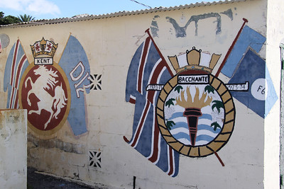 A wall in Dockyard, Bermuda bearing the crests of HMS Kent and HMS Bacchante
