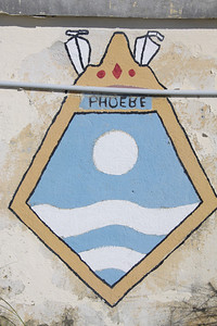 Crest of HMS Phoebe at Dockyard, Bermuda. HMS Phoebe was a leander class frigate launched in 1964 and decommissioned in 1991.
