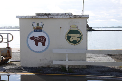 A small building in Dockyard, Bermuda bearing the crests of the yacht Jezebel and HMS Warspite