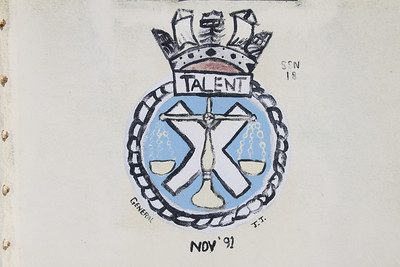 Crest of HMS Talent at Dockyard, Bermuda. There have been three Royal Navy submarines named HMS Talent. The third (S92) is a Trafalgar class nuclear powered submarine launched in 1988 and currently in active service (2012). The crest indicates that she visited Bermuda in November 1991.