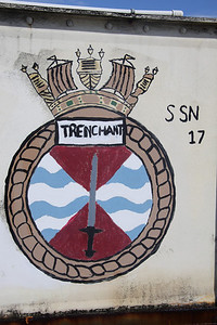 Crest of HMS Trenchant at Dockyard, Bermuda. There have been three Royal Navy vessels named HMS Trenchant. The third (S91) is a Trafalgar class nuclear powered submarine launched in 1986 and still in active service (2012).