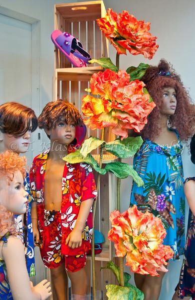 Childrens beach clothes displayed in a shop window in Hamilton, Bermuda, British Overseas Territory.
