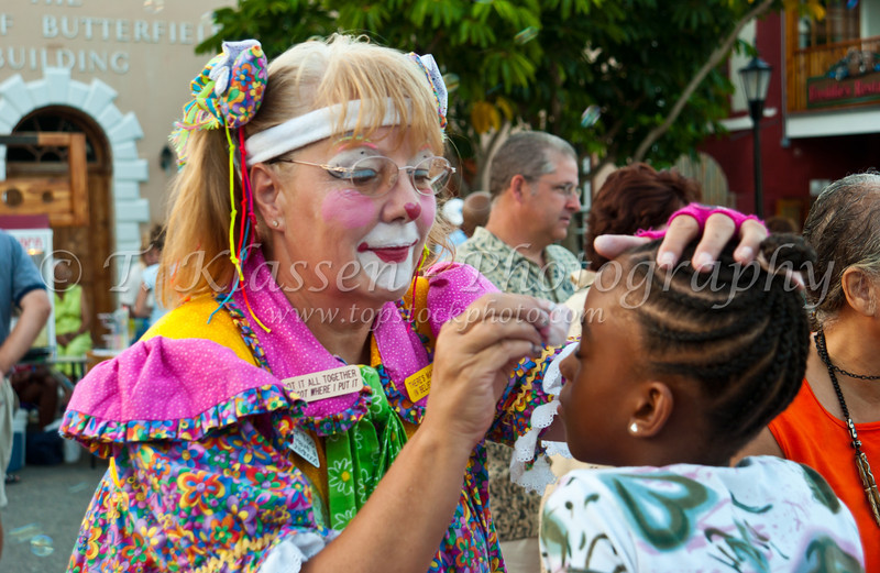 Dottie the clown performs face painting at a street festival in St. George's, Bermuda.