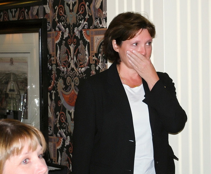 Karen Johnson waiting to photograph the winner suddenly realizes that she is being honored.