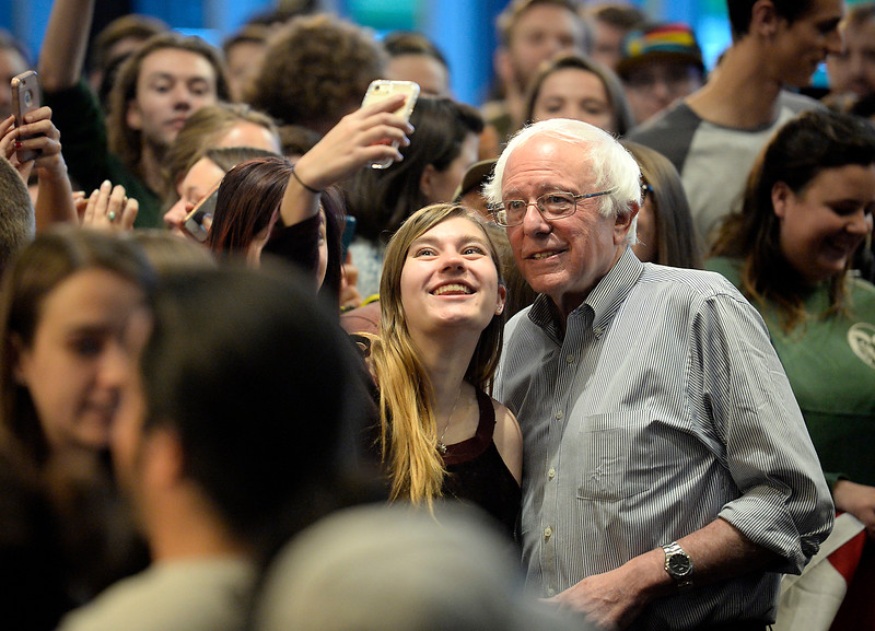 Bernie Sanders poses for a selfie with an attendee after speaking and stumping for Hillary Clinton Monday, Oct. 17, 2016, in the Lory Student Center at Colorado State University in Fort Collins. (Photo by Jenny Sparks/Loveland Reporter-Herald)