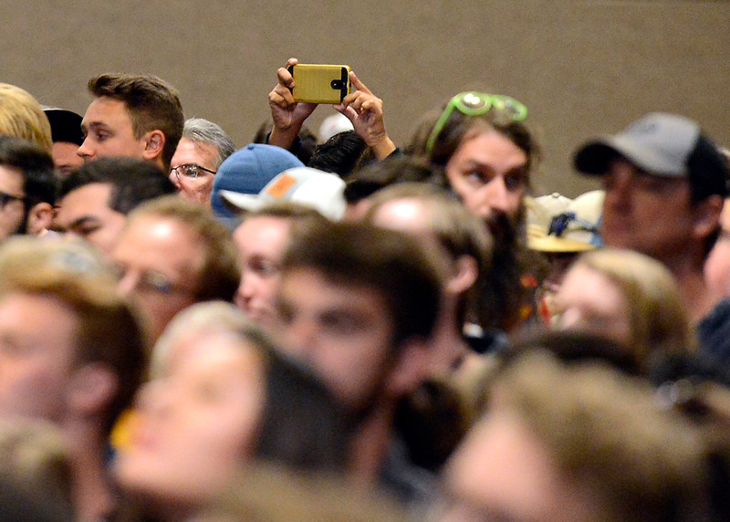 An attendee uses their cell phone to take photos as Bernie Sanders speaks to a crowd of people while stumping for Hillary Clinton Monday, Oct. 17, 2016, in the Lory Student Center at Colorado State University in Fort Collins. (Photo by Jenny Sparks/Loveland Reporter-Herald)