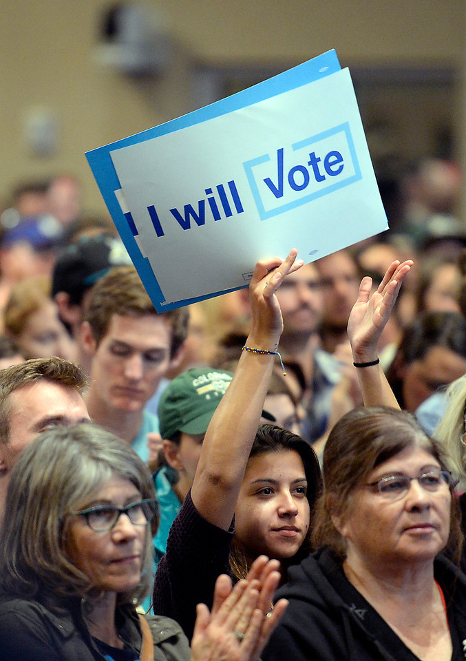 Catalina Forero holds up a sign as Bernie Sanders speaks to a crowd of people while stumping for Hillary Clinton Monday, Oct. 17, 2016, in the Lory Student Center at Colorado State University in Fort Collins. (Photo by Jenny Sparks/Loveland Reporter-Herald)