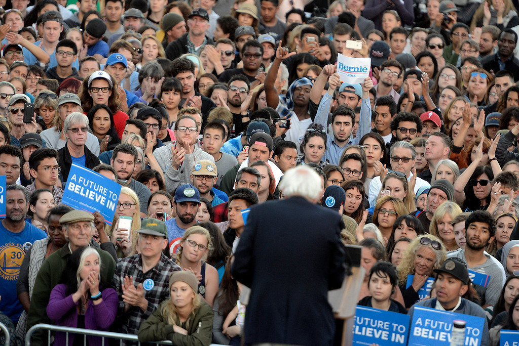 . Fans watch as Bernie Sanders speaks at Colton Hall in Monterey, Calif. on Tuesday May 31, 2016. (David Royal - Monterey Herald)