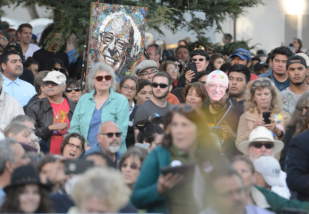 . A painting of Bernie Sanders hangs against a pole as he speaks at Colton Hall in Monterey, Calif. on Tuesday May 31, 2016. (David Royal - Monterey Herald)