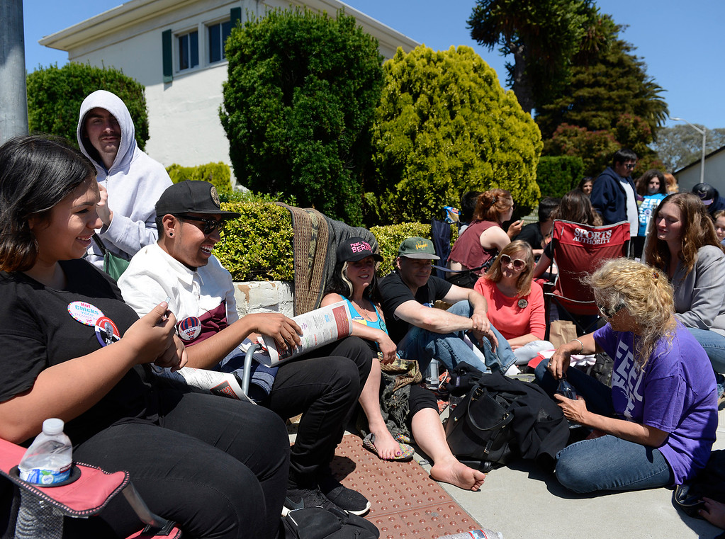 . Marina Martinez, seated left, and Tomas Rodriguez of Watsonville were the first people in line to see Bernie Sanders speak at Colton Hall in Monterey, Calif. on Tuesday May 31, 2016. (David Royal - Monterey Herald)