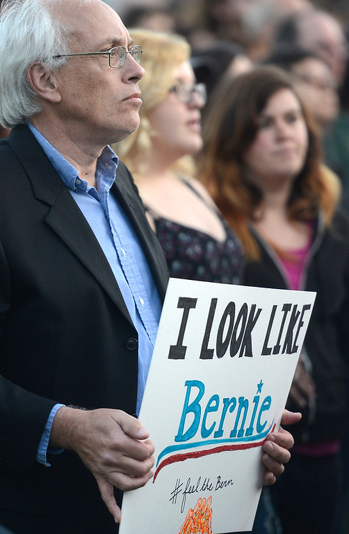 ". Jerry Schmidt of Monterey holds a sign saying ""I look like Bernie\"" as Sanders speaks at Colton Hall in Monterey, Calif. on Tuesday May 31, 2016. (David Royal - Monterey Herald)"