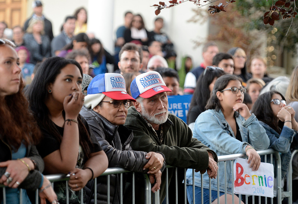 . Juanita and Mark Boutwell of Salinas wear matching hats as they listen to Bernie Sanders speaks at Colton Hall in Monterey, Calif. on Tuesday May 31, 2016. (David Royal - Monterey Herald)