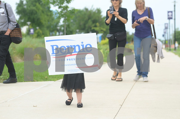 -Messenger photo by Jesse Major<br /> Lillian Stewart, 20 months old, of Rockwell City, holds up a sign supporting Sen. Bernie Sanders, I-Vermont, for president.