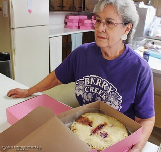 Lola Adamczak stands Saturday in the kitchen of the Berry Creek Grange with one of the several hundred stars of the 20th annual Berry Festival, a hand-made blackberry pie. (Steve Schoonover -- Enterprise-Record)