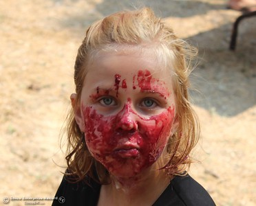 """The face of a winner: Sky Bartley stares into the camera after helping her team win a pie-eating contest Saturday at the 20th annual Berry Festival in Berry Creek. Sky was partnered with a couple of Plumas National Forest firefighters taking on a Cal Fire-led team. Readers can submit photos for consideration to """"Hot Shot"""" at photo@chicoer.com or tag their photos with #thisischico on Instagram. (Steve Schoonover — Enterprise-Record)"""