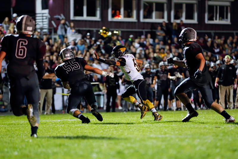 Thompson Valley's Aden Schaffer (52) runs past Berthoud High School's Benjamin Douglas (55) towards the end zone Friday evening Sept. 30, 2016 at Marr Field in Berthoud.<br /> <br /> Photo by Michael Ortiz/ Loveland Reporter-Herald