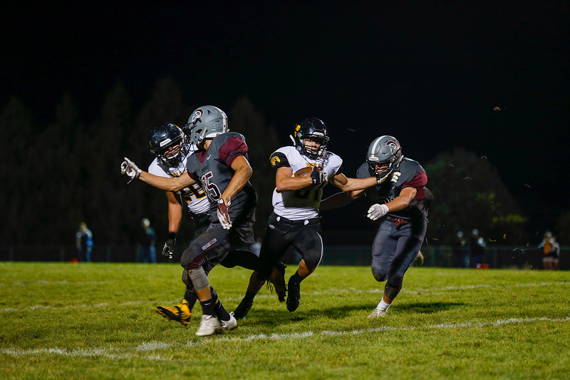 Matt Berg (81) breaks a tackle from Berthoud High School defense and heads toward the end zone on a pass on Friday evening Sept. 23, 2016 at Marr Field in Berthoud.<br /> <br /> Photo by Michael Ortiz/ Loveland Reporter-Herald