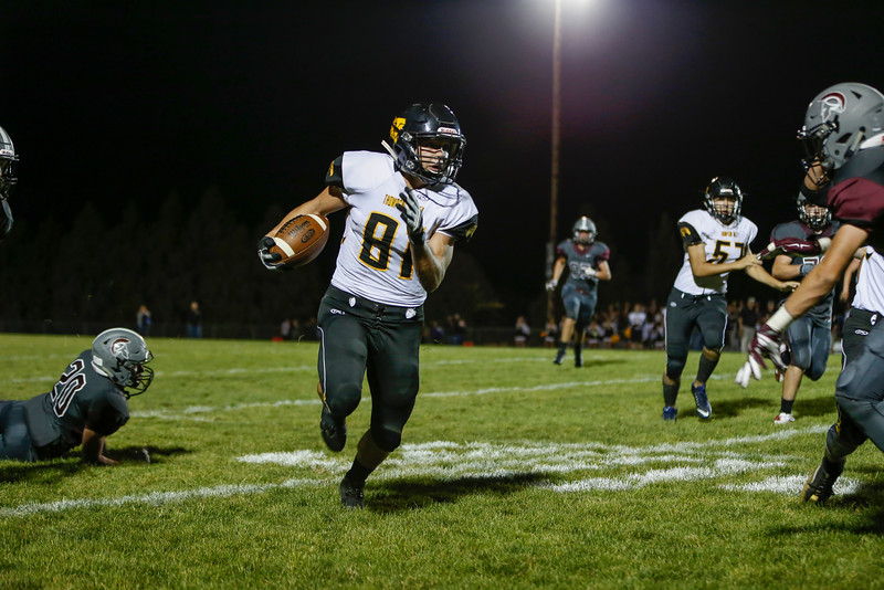 Thompson Valley's Matt Berg runs for a first down Friday Evening Sept. 30, 2016 at Marr Field in Berthoud. <br /> <br /> Photo by Michael Ortiz/ Loveland Reporter-Herald