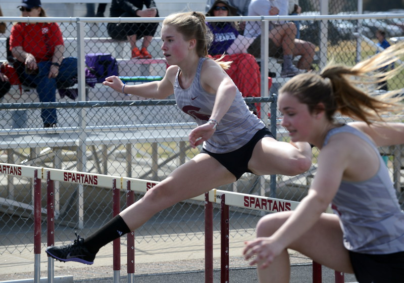 Berthoud's Allison Hocker (left) and Katharine Rafferty compete in the 100-meter hurdles at Thursday's NoCo meet at Marr Field iin Berthoud. (Mike Brohard/Lovelnad Reporter-Herald)
