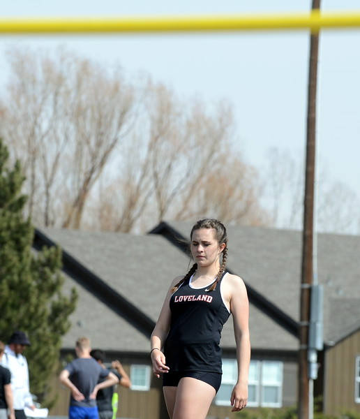 Hunter Thomas of Loveland steadies herself before her approach in the high jump at Thursday's NoCo meet at Marr Field iin Berthoud. (Mike Brohard/Lovelnad Reporter-Herald)