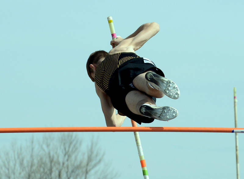 Thompson Valley's Airiel Siegel rises up in his attempt to clear the bar in the pole vault at Thursday's NoCo meet at Marr Field iin Berthoud. (Mike Brohard/Lovelnad Reporter-Herald)