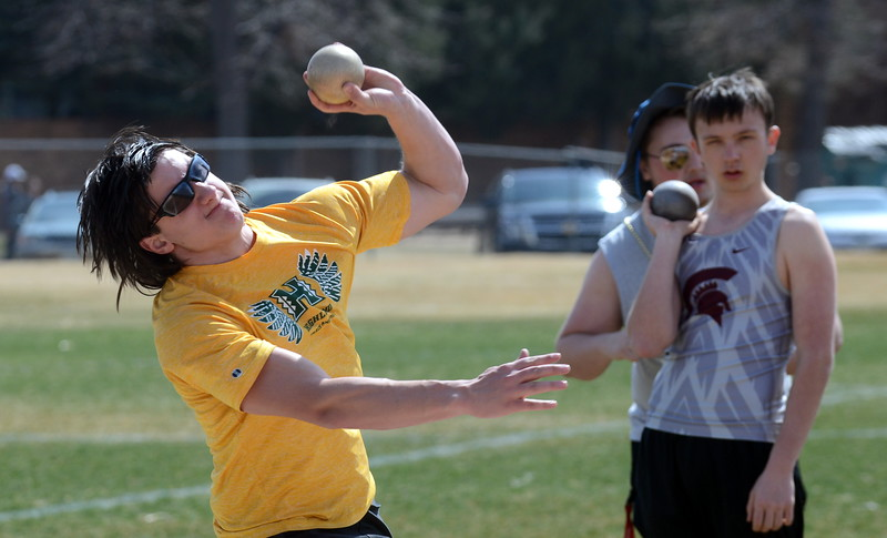 Thompson Valley's Devin Hines comes through on his throw during the shot put at Thursday's NoCo meet at Marr Field iin Berthoud. (Mike Brohard/Lovelnad Reporter-Herald)