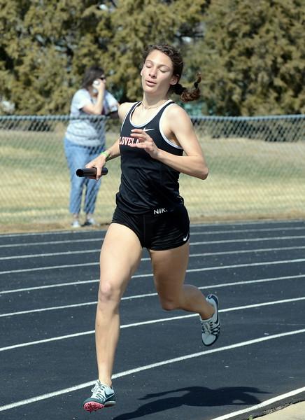 Loveland's Kennedy Burch runs her leg of the 3,200 relay at Thursday's NoCo meet at Marr Field iin Berthoud. (Mike Brohard/Lovelnad Reporter-Herald)