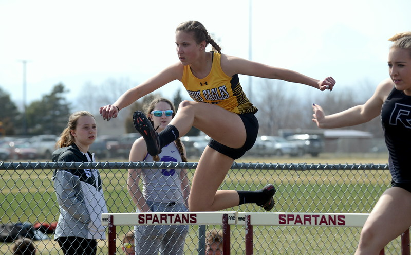 Thompson Valley's Anneliese Metzger is all concentration as she clears a hurdle during the 100-meter event at Thursday's NoCo meet at Marr Field iin Berthoud. (Mike Brohard/Lovelnad Reporter-Herald)