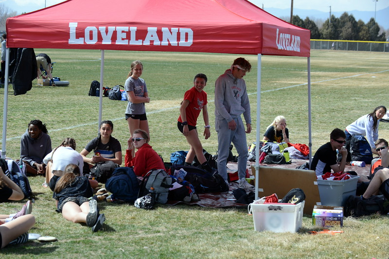 Loveland's track team relaxes before the start of Thursday's NoCo meet at Marr Field iin Berthoud. (Mike Brohard/Lovelnad Reporter-Herald)