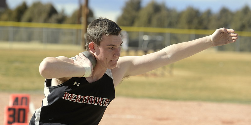 Peter Scheller of Berthoud has the shot put tucked as he comes around during the finals of the Spartan Spike 1 meet Thursday at Marr Field. Scheller won the event with a throw of 42-1.5. (Mike Brohard/Reporter-Herald)