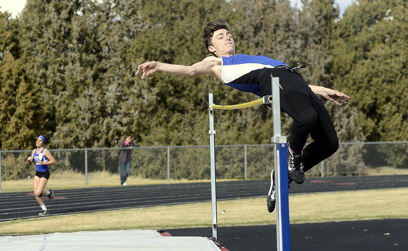 Resurrection Christian's Ryan Bauer clears the bar on his way to a second-place finish in the high jump Thursday at the Spartan Spike 1 at Marr Field. Bauer finished at 5-8. (Mike Brohard/Reporter-Herald)