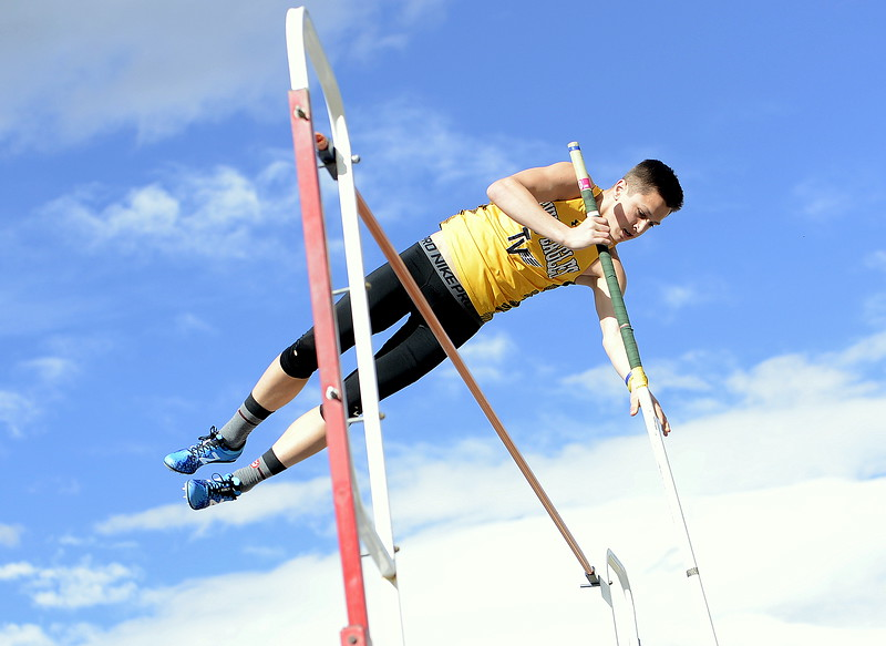 Thompson Valley's Hayden Ell clears the bar with a winning vault of 12-3 at the Spartan Spike 1 meet Thurday at Marr Field. It marked a personal best for the senior. (Mike Brohard/Reporter-Herald)