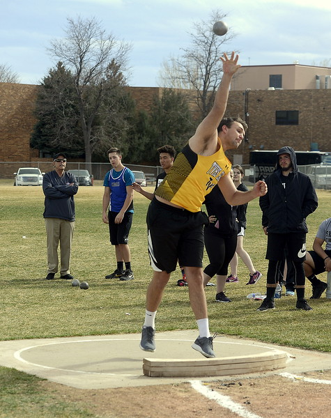 Jared Kasprzak lets loose of the shot put during the finals of the Spartan Spike 1 on Thursday at Marr Field. Kasprzak was fifth with a throw of 39.7.5. (Mike Brohard/Reporter-Herald)