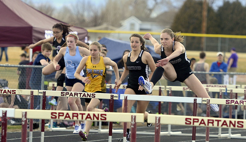 Samantha Mulder clears the third hurdle during the 100-meter hurdles at the Sparan Spike 1 at Marr Field on Thursday in Berthoud.  Mulder won the event in 17.60. (Mike Brohard/Reporter-Herald)