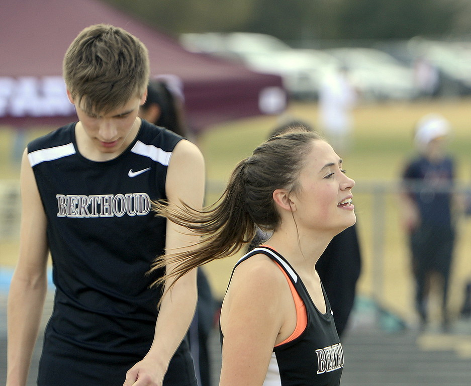 Berthoud's Macy White cheers on the Spartans' sprint medley relay team during Thursday's Spartan Spike 1 at Marr Field. (Mike Brohard/Reporter-Herald)