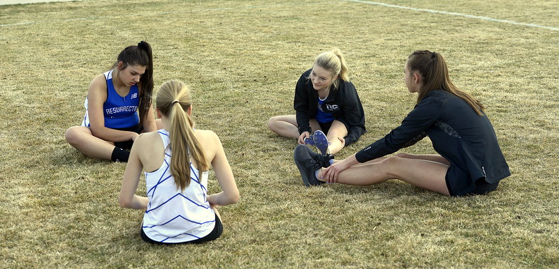 Resurrection Christian's (left to right) Annika Lederman, Caitlyn Evans, Collette Bangma and Danika Hekowczy stretch prior to the running events at Thursday's Spartan Spike 1 at Marr Field. (Mike Brohard/Reporter-Herald)