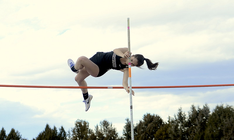 Emma Jo Briles of Berthoud clears 9 feet in the pole vault to win the event at the Spartan Spike 1 at Marr Field in Berthoud on Thursday. Briles is learning to vault from the opposite side after shoulder surgery. (Mike Brohard/Reporter-Herald)