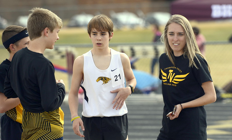 Former Thompson Valley standout Karina Ernst, now serving as an assistant coach for the Eagles, talks to the distance runners during a break at the Spartan Spike 1 meet Thursday at Marr Field. (Mike Brohard/Reporter-Herald)