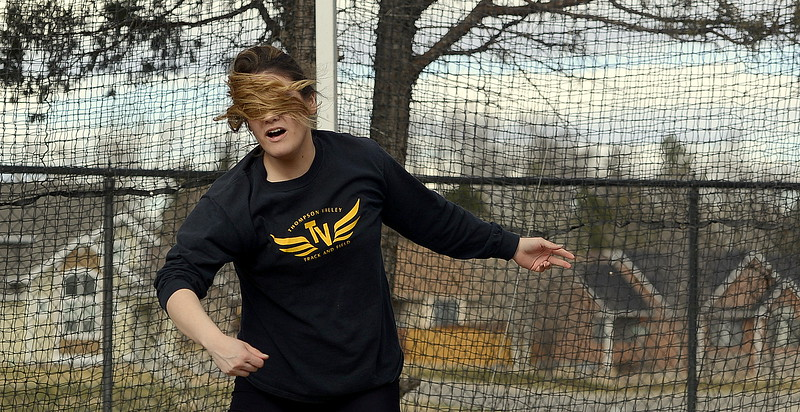Thompson Valley discus thrower Cindy Ybarra gets a face full of her own pony tail as she follows through on her toss in Thursday's finals at the Spartan Spike 1 at Marr Field. Ybarra won with a toss of 102-7. (Mike Brohard/Reporter-Herald)