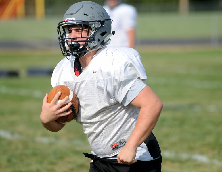 Berthoud senior AJ Anema takes the ball upfield during a recent practice at BHS.