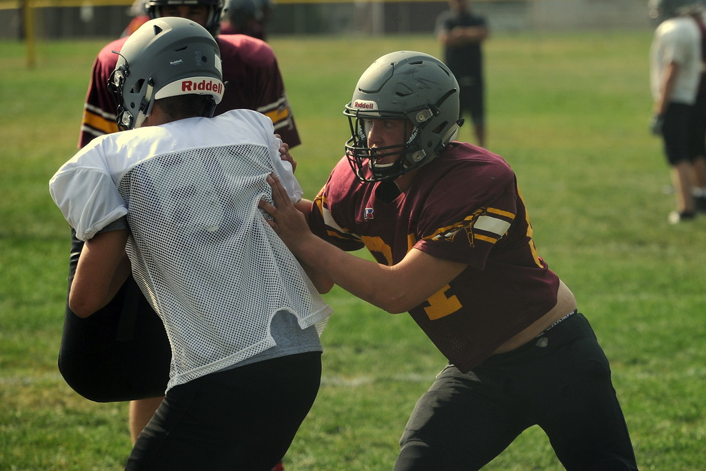 . Berthoud senior Levi Decker, right, works on a defensive drill during a recent practice at BHS.