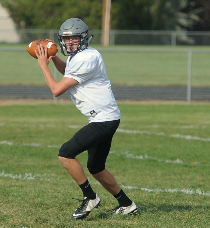 Berthoud senior Brock Voth drops back to throw during a recent practice at BHS.