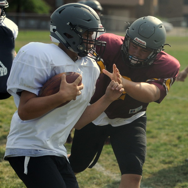 Berthoud junior Ty Beaman, right, chases a teammate during a recent practice at BHS.