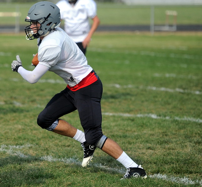 Berthoud senior Jake Rafferty runs upfield after making a catch during a recent practice at BHS.