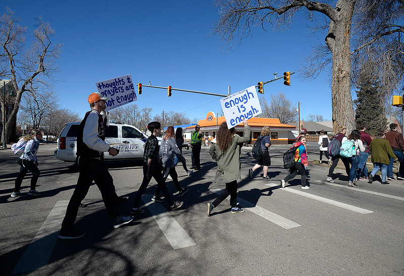 Berthoud High School students cross Mountain Avenue Tuesday, March 7, 2018, while marching in support of mental health in schools in Berthoud. (Photo by Jenny Sparks/Loveland Reporter-Herald)