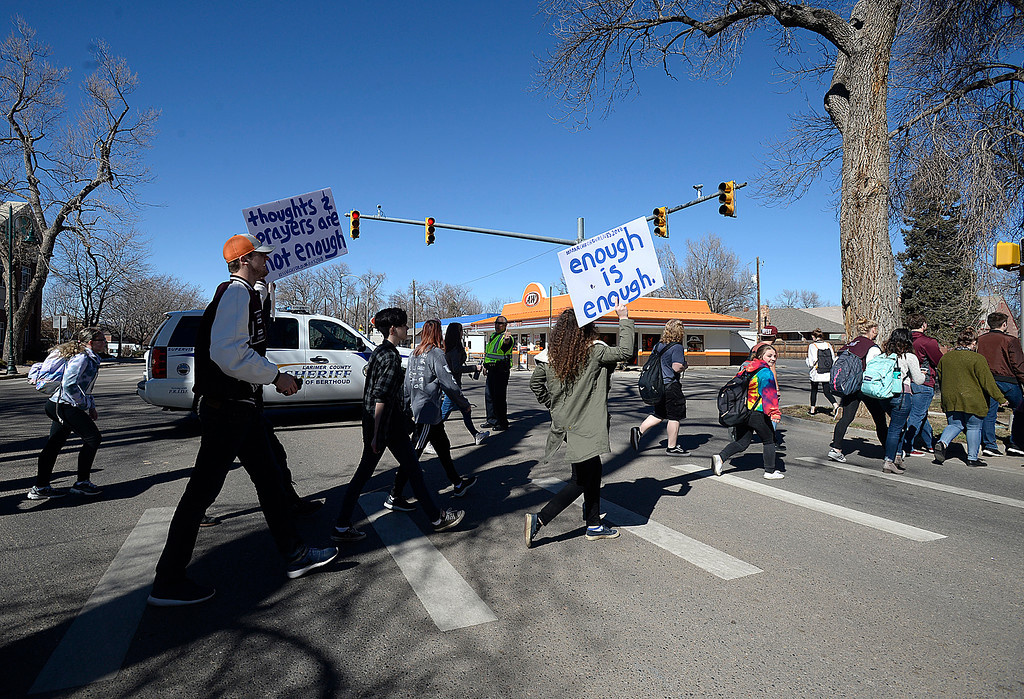 . Berthoud High School students cross Mountain Avenue Tuesday, March 7, 2018, while marching in support of mental health in schools in Berthoud. (Photo by Jenny Sparks/Loveland Reporter-Herald)
